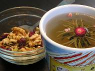 Walnuts, cranberries, sunflower seeds, and pumpkin seeds with flowering tea