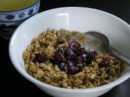 Granola cereal with almond milk, cranberries, and green tea