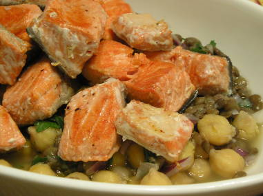 Lentil salad with chickpeas, onion, and salmon